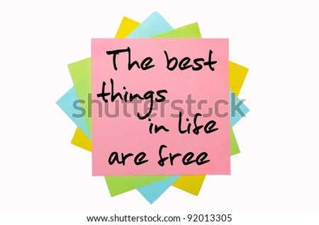 "text "" The best things in life are free "" written by hand font on bunch of colored sticky notes"