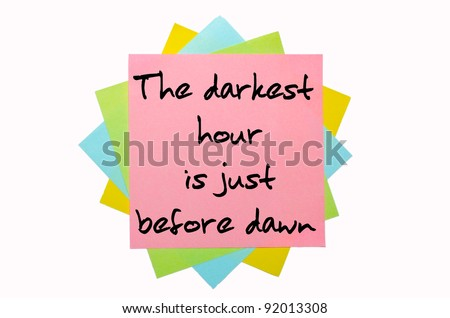 "text "" The darkest hour is just before dawn "" written by hand font on bunch of colored sticky notes"
