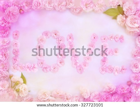 Text the LOVE of roses in a frame of roses. Partial blur. Special toning.  - stock photo