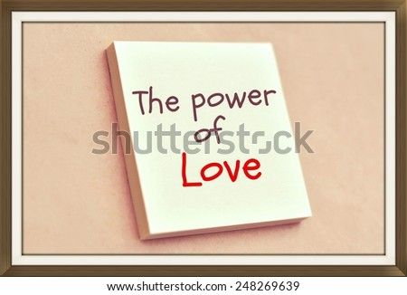 Text the power of love on the short note texture background  - stock photo