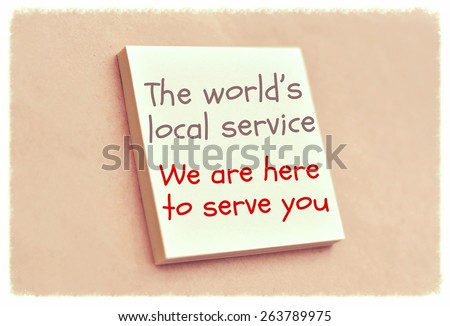 Text the world's local service we are here to serve you on the short note texture background - stock photo