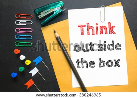 Text Think outside the box on white paper background - stock photo