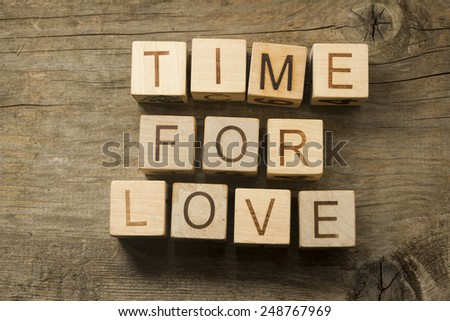 text time for Love on a wooden background - stock photo