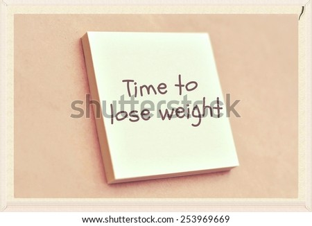 Text time to lose weight on the short note texture background - stock photo