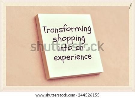 Text transforming shopping into an experience on the short note texture background - stock photo