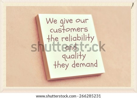 Text we give our customers the reliability and quality they demand on the short note texture background - stock photo