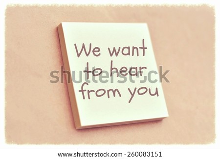 Text we want to hear from you on the short note texture background - stock photo