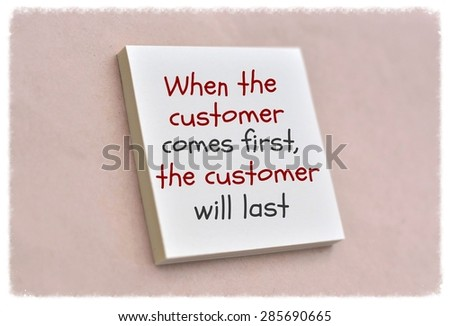 Text when the customer comes first the customer will last on the short note texture background - stock photo