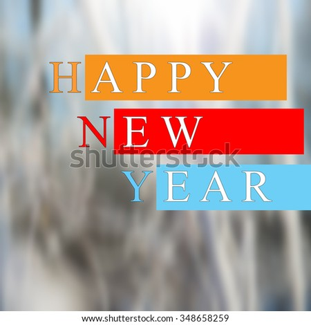 text with a happy new year on a blurred background