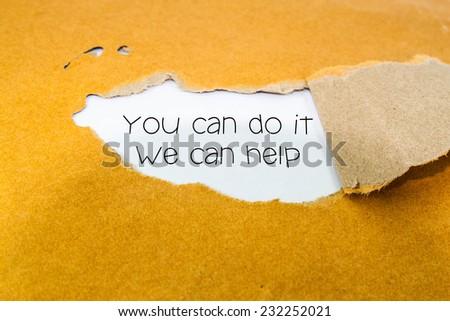 Text you can do it we can help on the brown envelope  - stock photo