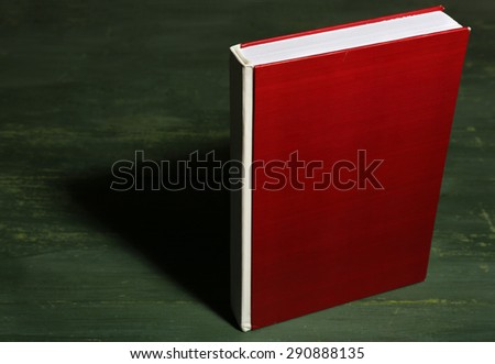 Textbook on wooden background - stock photo