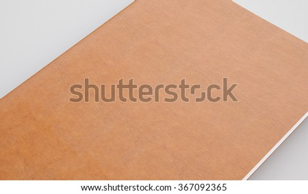 Textbook with leather cover on the light background. 3d render - stock photo