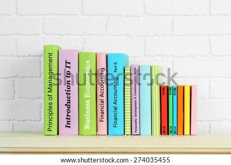 Textbooks on shelf close-up - stock photo