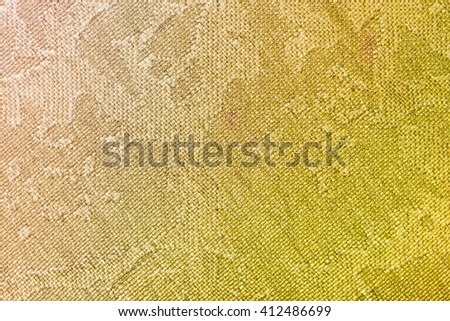 textile background - brown and yellow batik silk fabric with Jacquard weave pattern of threads close up - stock photo