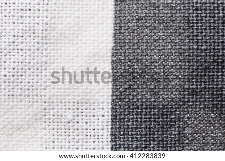 textile background - white and gray cotton fabric with Calico weave pattern of threads close up - stock photo