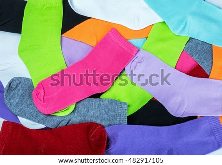 Textile colorful socks background. Green, pink, red, blue, yellow and other colors