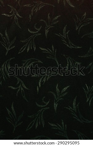 textile, gray leaves on black, textural background - stock photo