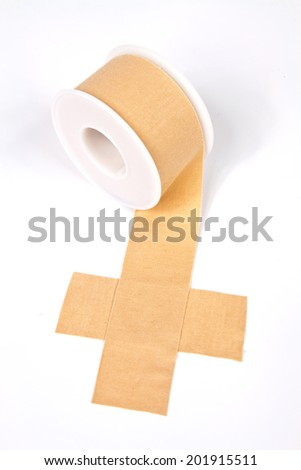 Textile medical adhesive tape roll designed to provide medical assistance - stock photo