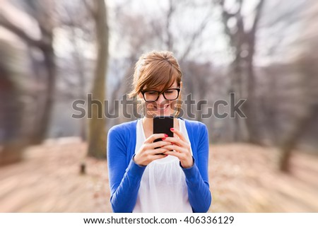 Texting on a smartphone. - stock photo