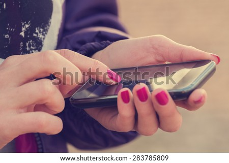 Texting on a smartphone. Shallow depth of field. - stock photo
