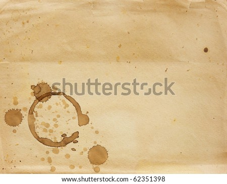 Texture - a sheet of the old paper with drops of coffee - stock photo