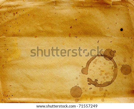 Texture - a sheet of the old, soiled paper with drops of coffee - stock photo