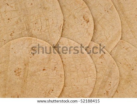 texture and pattern of overlapping wheat flour tortillas - stock photo