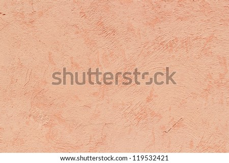 Texture background of an orange plaster wall. - stock photo