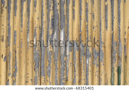 Texture background of old yellow corrugated wall - stock photo