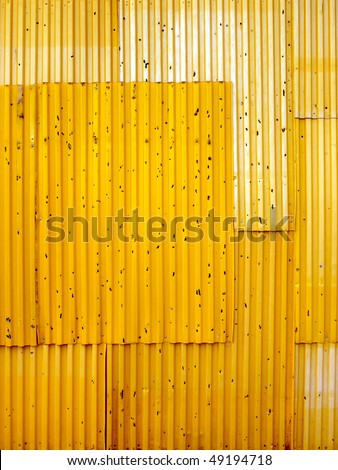 Texture background of yellow corrugated fence.