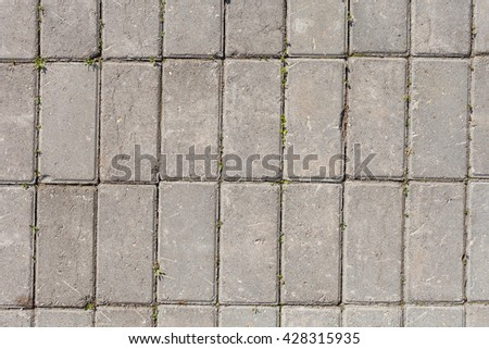 Texture brick tiles. Masonry Pattern. Road stone laid on the road track. Material for the pedestrian walkway path - stock photo