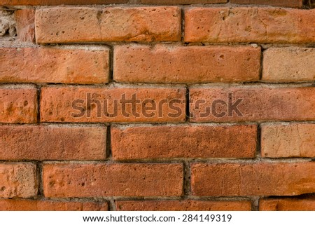 Texture. Brick. Wall. A background with attritions and cracks - stock photo