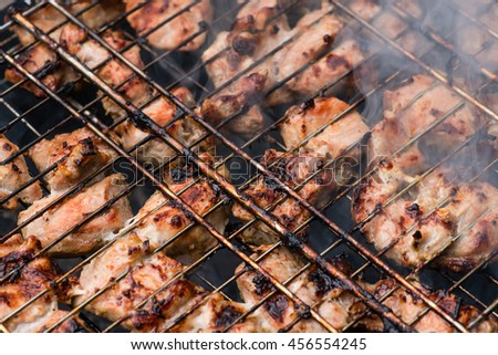 texture Closeup of meat fried on a grill with smoke