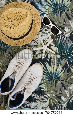 texture cloth with hat, sunglasses.shell ,palm leaves painted on cloth, abstract pattern.