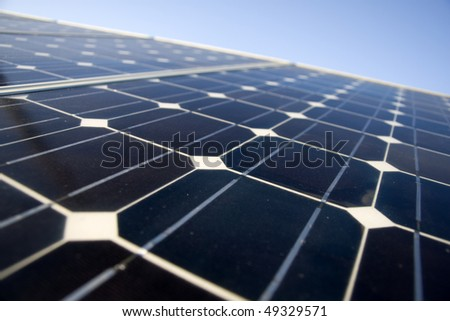 Texture detail of photoelectric cells of a solar panel (Blue and ecology energy) - photographed with shallow DOF - stock photo