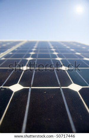 Texture detail of photoelectric cells of a solar panel (Blue and ecology energy). Photographed with shallow DOF - stock photo