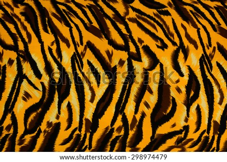 Texture fabric of tiger for background - stock photo