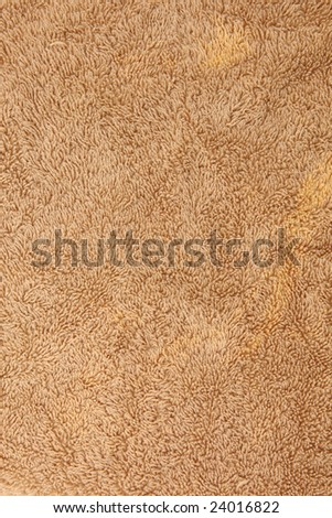Texture image of a brown fuzzy towel.