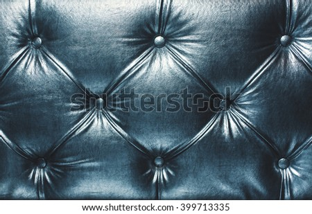 Texture leather upholstery sofa with rivets. - stock photo