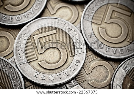 Texture made of extreme closeup of 5 Polish Zloty coins - stock photo