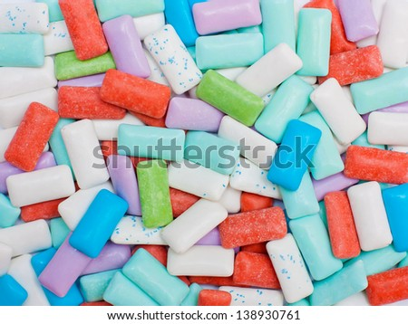 Texture made out of many chewing gum pellets of different colors. - stock photo