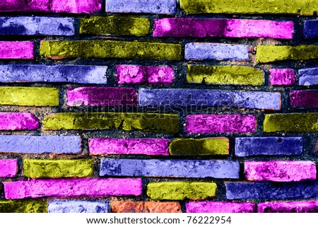Texture of a colored brick wall. Useful as background for design-works. - stock photo