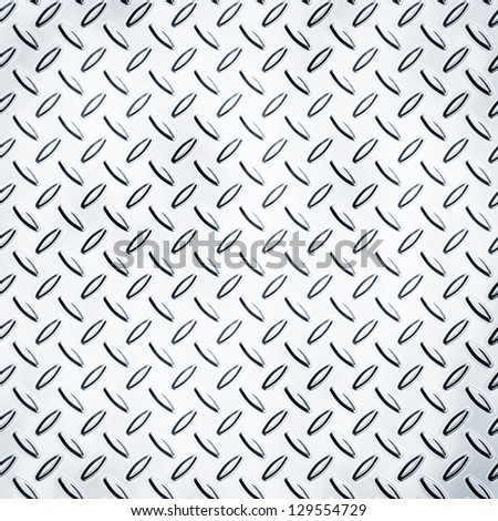 Texture of a metal diamond plate - stock photo