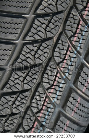 Texture of a new black tire in close view
