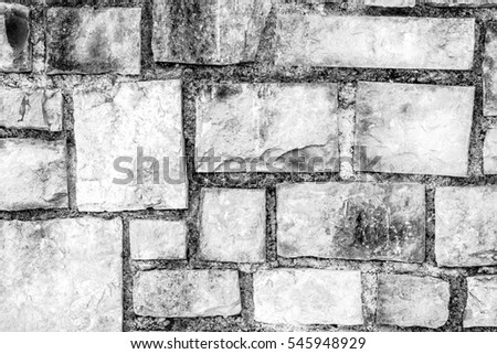 Texture of a outdoor wall with nice stones, black & white, horizontal.