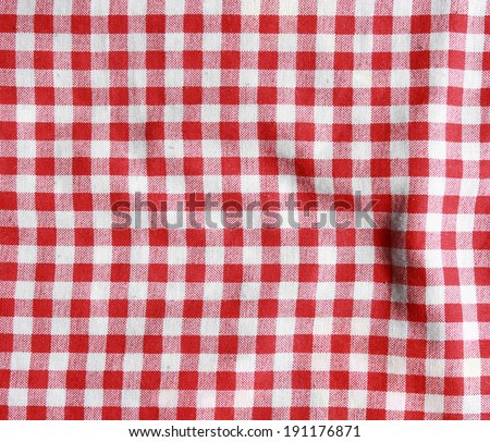 Texture of a red and white checkered picnic blanket. Red linen tablecloth.
