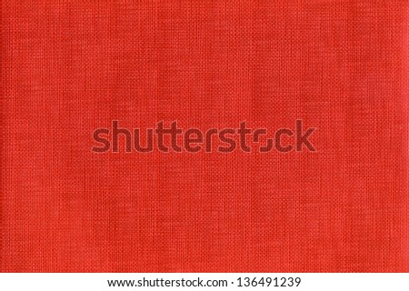 Texture of a red color canvas with a dense grid. Scan image. - stock photo