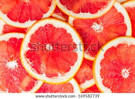 Texture of a ripe grapefruit slice, closeup - stock photo