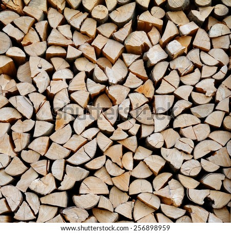 Texture of a stack of chopped firewood  - stock photo