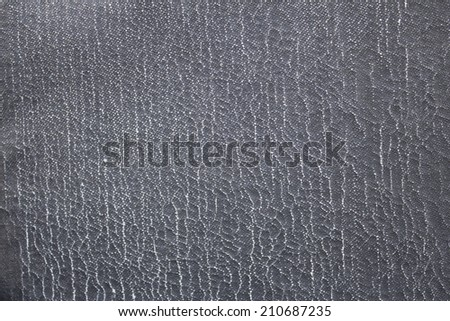Texture of a wall covered with roofing material - stock photo